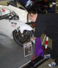 Sara polishing tyres, Stafford, Oct 2009